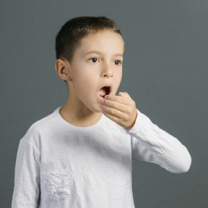 bad breath from boy in need of affordable dental care