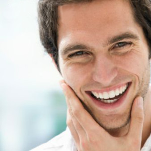 Image of a happy patient that found out about the benefits of having a root canal procedure in Lincoln, NE.