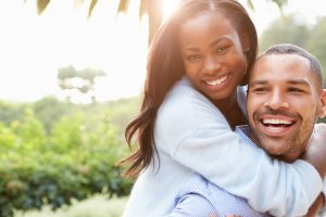 Image of a happy couple who has learned about their options and the teeth whitening process for a beautiful, white smile.
